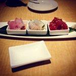 Sashimi sampler: ahi poke, whitefish ceviche, and jalapeño yellowtail