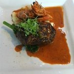Steak and the biggest prawns served with a delicious sauce