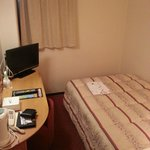 Room is small and just a single bed and a small desk.