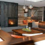 Fireplace seating area near Spur and storage room for skiing equipment