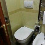 note the distance between door and toilet bowl