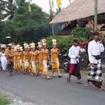 local village girls and boys going to the temple to take part in the ceremony.