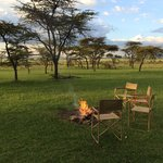 The campfire we sit around for sunset and before dinner, overlooking the plains of the Mara