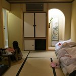 Our small room with 3 futons stacked to the side