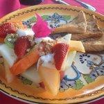 French Toast served with fresh fruit, yogurt, and granola.
