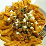 Penne with vodka sauce, sausage, and peas