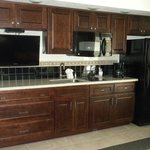 713 Kitchen area with wall TV and full sized refrigerator