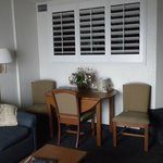 713 Dining area and shutters opened to bedroom