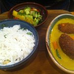 Coconut curry with fried aubergine, courgettes and garden peas  with split pea and sesame dumpli