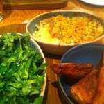 Leek and cheddar crumble with garlic kale and potato wedges