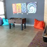 Aloft hotel lobby  With some entertainment  Babyfoot and Pool  The wall hang drawings also fo