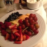 Fruit and yogurt plate room service breakfast.