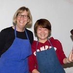 Jennifer (holding the spoon) from the Yangshuo Cooking School