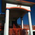 Under the orange roof.