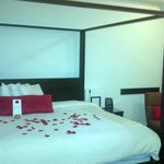 Standard room king bed with silk rose petals