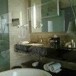 Bathroom look via transparent wall fom the room