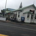 Rare rainy day in Mangonui, 1904 Cafe sign now up so you can find us!