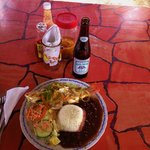 FRESH Red Snapper with stew beans, rice and salad..and Belikin Stout.I get this everytime:)