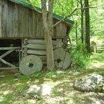 log barn and millstones