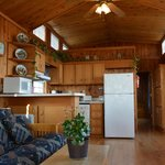 Cabin have fireplaces or AC, full kitchens, access to the pool grill and are expected at breakfa