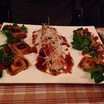 Filet de sandre, ravioles aux cèpes, sauce type aigre douce filaments de de lard grillé, mâche e