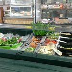 Fresh salad fixings and deli in background.  Very nice.