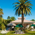 Lush, tropical gardens with BBQ tiki huts