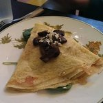 chicken crepe with mushrooms, onions, cheese, and olive oil