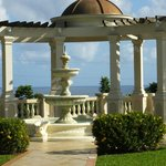 A Roman style archway over looking the ocean and a place for weddings;