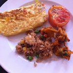 omelette, tomatoes, nasi goreng and onion bhaji - the breakfast of champions!