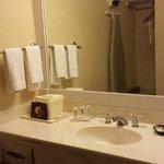 sink, small hanging closet, iron / board