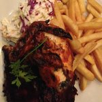 My dinner, which was amazing, piri piri chicken, bbq ribs and chips and SLAW