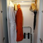 Closet. Light turns on when you open it. And you get an umbrella
