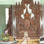 Wooden Buddha statue at Shwedagon Pagoda