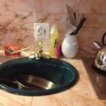 bathroom sink in kitchen. huh?
