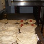 fresh pizzas being made