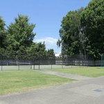 tennis court, golf net and basketball court
