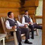 Enjoying Paul Bunyan log cabin porch