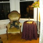 Sitting room, with two parlor chairs, two floor lamps & table