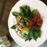 Cous cous, quinoa & freekeh salad. Topped with grilled asparagus, haloumi, chilli, mint and lemo