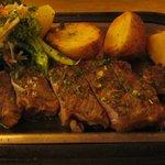 Steak with potato slices