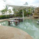 Seating at Lomani Wai. Feet in water :)