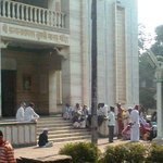 Devotees sitting on the Lt side entrance and enjoy its ambiance.