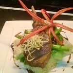 Pork cutlet braised in red wine stock with sticky mango coconut rice, pak choy , asparagus and c