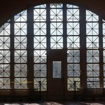 The beautiful windows in the entrance hall that the newly arrived saw.