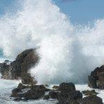 Waves crashing over the lava rock