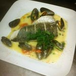 Fresh fillet of Hake. Served with Mussels,Coriander, garlic, Cherry tomatoes and a White Wine Sa
