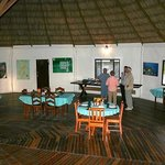 "The inside of the ""palapa"" which serves as a communal dining and lounge area"