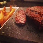Steak on the rock with chunky chips