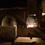 Wood roasting oven and mesquite grill.
